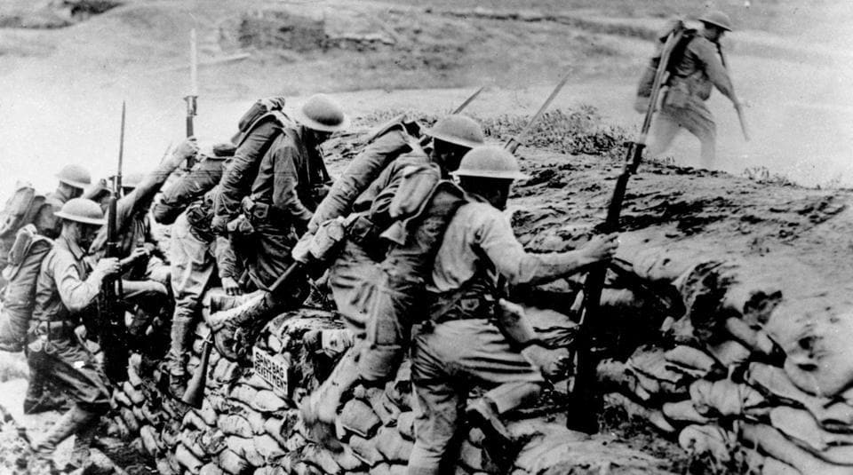 In this picture, American troops can be seen climbing over a sandbag revetment in France during World War I in 1918. This year marks a century since the end of the Great War, the one fought in trenches, across continents, by heroic young men against deadly new technologies and by nations fuelled by greed.
