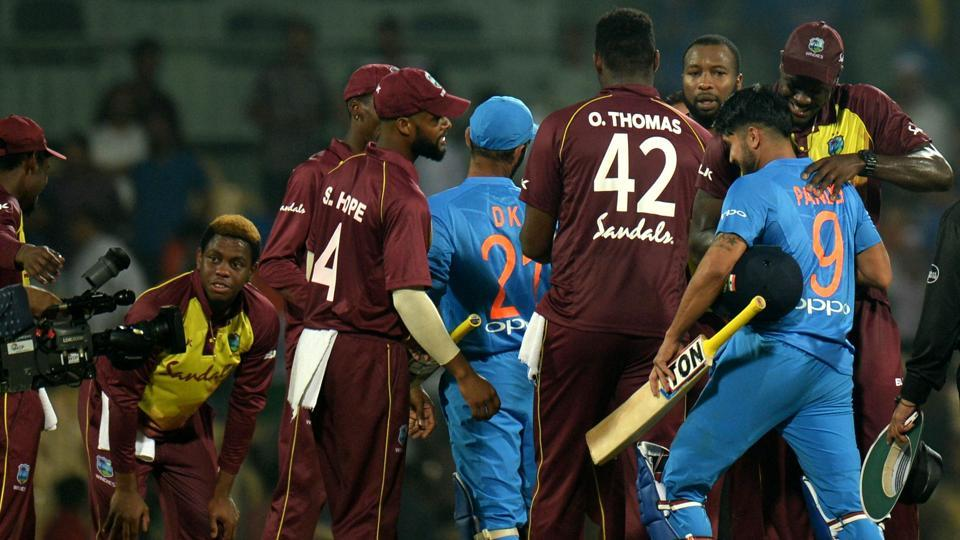 West Indies T20 cricket captain Carlos Brathwaite (R) hugs to congratulate Indian crickter Manish Pandey (2R) after their loss during the Third T20 cricket match between India and West Indies at the MA Chidambaram Cricket Stadium in Chennai. (AFP)
