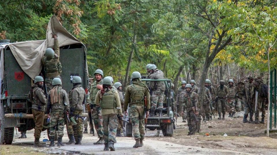 Army soldiers cordon off an area during an encounter in Handwara, on Oct 11, 2018.