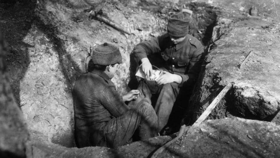 British soldiers making grenades from tins in their trenches, in 1915.