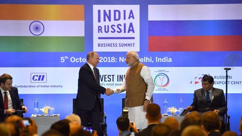 Russian President Vladimir Putin shakes hands with Prime Minister Narendra Modi during a session of the Russian-Indian business summit in New Delhi on October 5.