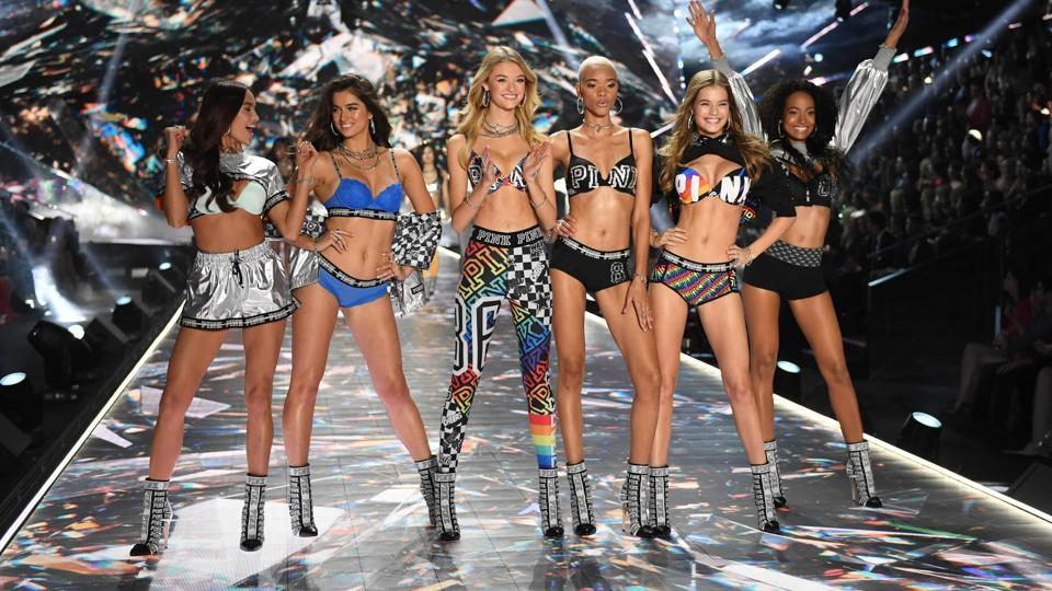 Filipino model Kelsey Merritt, New Zealand model Maia Cotton, US model Willow Hand, US model Lesha Hodges, Dutch model Myrthe Bolt and Ivorian model Melie Tiacoh walk the runway at the 2018 Victoria's Secret Fashion Show.  Every year, the Victoria's Secret show brings its famous models together for what is consistently a glittery catwalk extravaganza. It's the most-watched fashion event of the year.   (AFP)