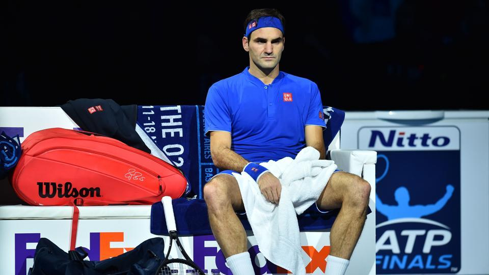 Switzerland's Roger Federer reacts after losing the first set to Japan's Kei Nishikori during their singles round robin match on day one of the ATP World Tour Finals tennis tournament