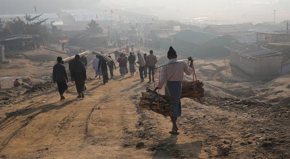 Rohingya refugees walk at Jamtoli camp in the morning in Cox's Bazar, Bangladesh on January 22.