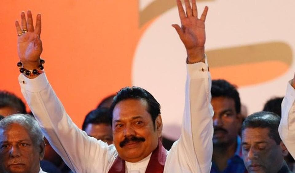 Sri Lanka's newly appointed Prime Minister Mahinda Rajapaksa waves at supporters during a rally near the parliament in Colombo, November 5