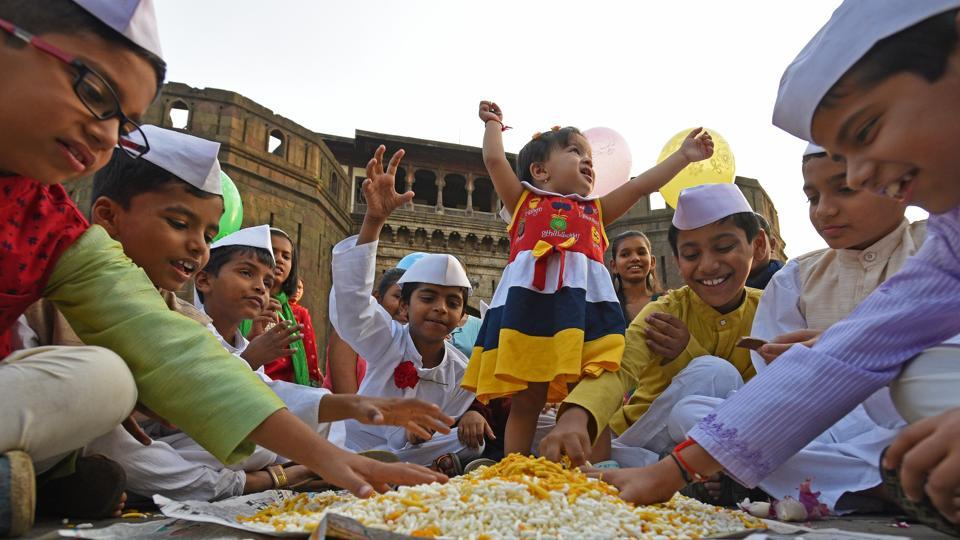 Children dressed as Jawaharlal Nehru, the first Prime Minister of India, share a light moment at Shaniwarwada on the eve of Children's Day or Bal Diwas on Tuesday. November 14 is celebrated as Children's Day to mark the birth anniversary of Nehru. (Pratham Gokhale/HT Photo)