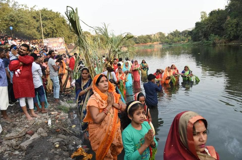 Chhath Puja is a festival dedicated to the Sun God, and his wife Usha. The festival is celebrated in Bihar, Uttar Pradesh, Jharkhand, Madhya Pradesh and Maharashtra. Internationally it is celebrated in Nepal and Mauritius. Women during the Chhath puja celebration at Chinchwad ghat on Tuesday. (HT PHOTO)