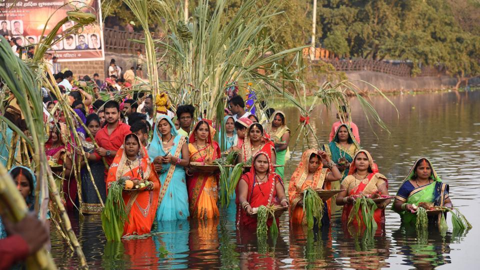 Women during the Chhath puja celebration at Chinchwad ghat on Tuesday. The four-day festival includes rigorous rituals such as holy bathing, fasting and offering prayers and food to the rising and setting sun.  (HT PHOTO)