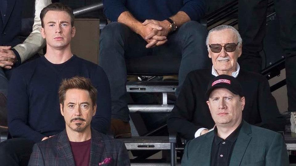 Clockwise: Robert Downey Jr, Chris Evans, Stan Lee and Marvel president Kevin Feige pose at a special Marvel event.