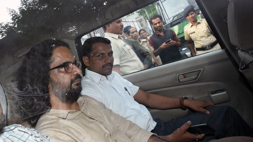 Rona Wilson, arrested for alleged Maoist links in Koregaon Bhima violence, being produced in court in Pune after his arrest in June 2018 (File Photo)