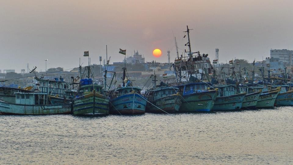 Fishing boats docked at a fishing harbor as a part of precautionary measures in view of cyclonic storm 'Gaja', in Chennai.