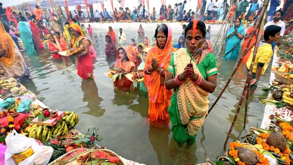 Hindu devotees offer prayers to the sun god during the Chhath festival while standing in a water body at ITO Yamuna Ghat in New Delhi, India. (Amal KS / HT Photo)