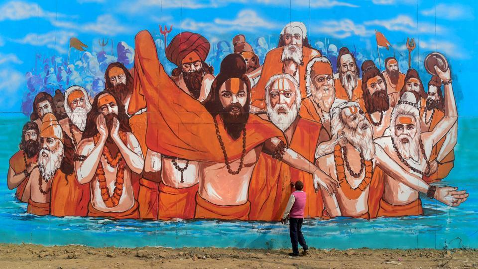 An artist makes a mural painting at a wall of the Naini Central Jail as part of the project 'Paint my City' for the upcoming Kumbh Mela festival in Allahabad, Uttar Pradesh. (PTI)