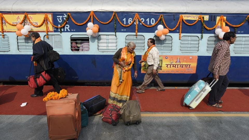 Passengers with their bags outside the newly launched tourist train