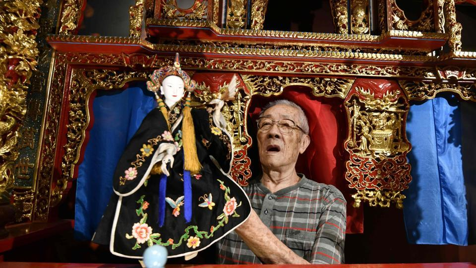 Chen Hsi-huang demonstrates how to use a puppet at the government-funded Puppetry Art Centre in Taipei. At 87 years old, Taiwanese glove puppeteer Chen is the star of a new documentary which reflects his determination to revive the dying traditional craft and a late-life renaissance as a high-profile promoter of the art form. (Sam Yeh / AFP)