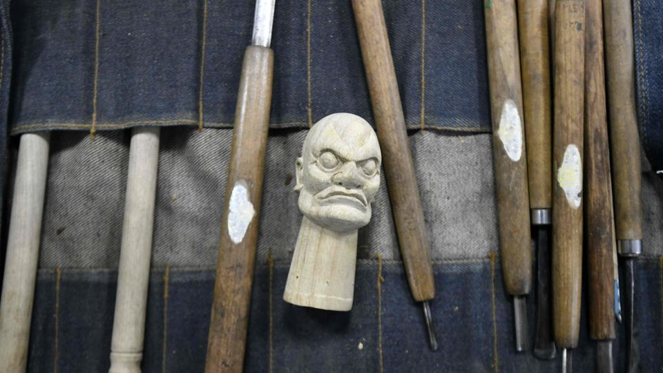 The sculpture tools and a puppet head displayed during the sculpture class. Taiwanese authorities are trying to promote the traditional craft, organising an annual puppet festival in Yunlin county. (Sam Yeh / AFP)