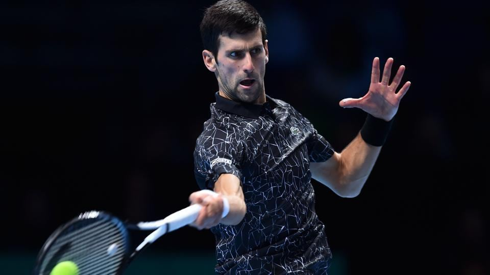 Serbia's Novak Djokovic returns against Germany's Alexander Zverev during their men's singles round-robin match.
