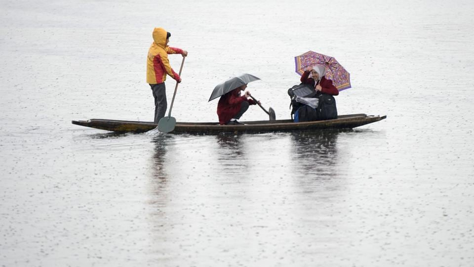 Kashmiri school children row their boat on Dal lake as they return home after school during a cold and rainy day in Srinagar, Jammu and Kashmir. (Tauseef Mustafa / AFP)