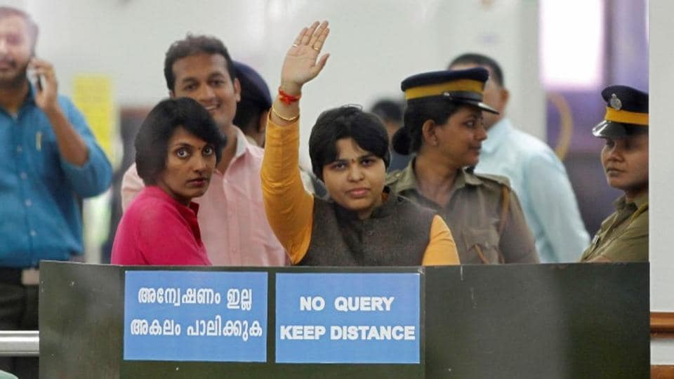 Trupti Desai, a women's rights activist, waves from inside the Cochin International Airport at Kochi on Friday.