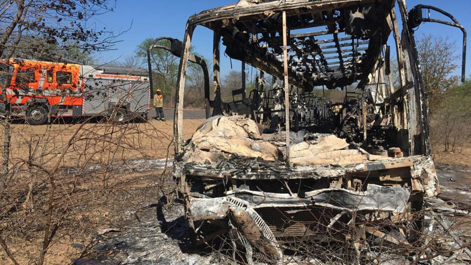 A fire engine is parked near to a burnt out bus after a bus accident in Gwanda about 550 kilometres south of the capital Harare. Police in Zimbabwe say more than 40 people have been killed in a bus accident.