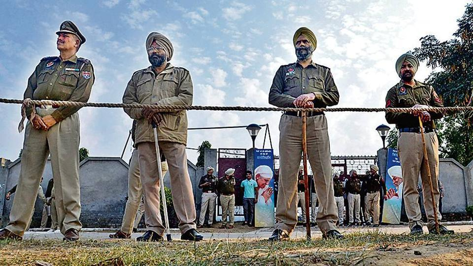 Police guard the venue of the prayer meet, situated in Amritsar's Rajasansi area, on Sunday.