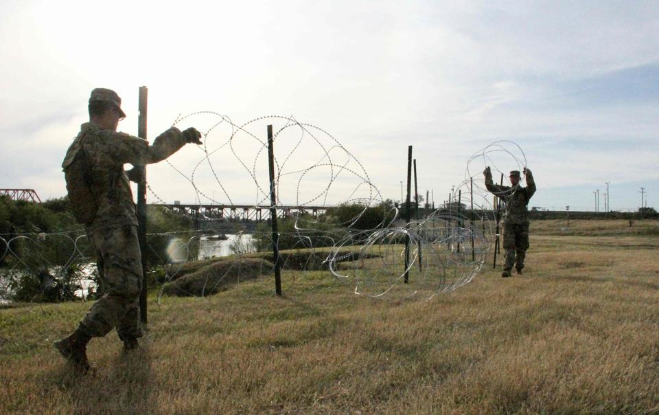 Soldiers from the Kentucky-based 19th Engineer Battalion work in a public park in Laredo, Texas, where they are installing barbed and concertina-wire on November 17, 2018.