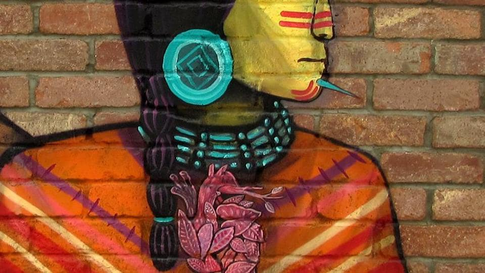 Saner is painting murals on walls in the Capital