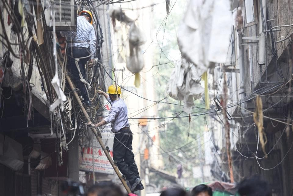 The firefighters on Monday said that four people were killed in a fire incident at a factory in Delhi's Karol Bagh after one of them, a heavy built man, got stuck at the exit door while escaping the building and blocked the route for others. Delhi Fire Service (DFS) officials said the fire started at 12.23 pm after a solvent used for laundering clothes spilled out on the floor accidentally. (Amal KS / HT Photo)