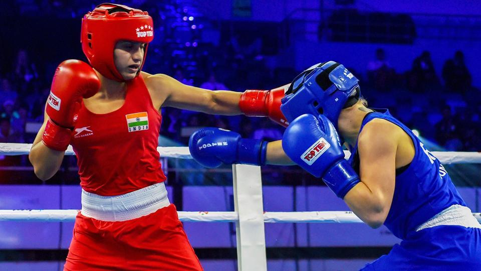 India's Pinki Rani (in Red) in action against England's Ebonie Jones during Fly category (51 kg) bout at preliminaries phase of AIBA Women's World Boxing Championships, in New Delhi, Monday.