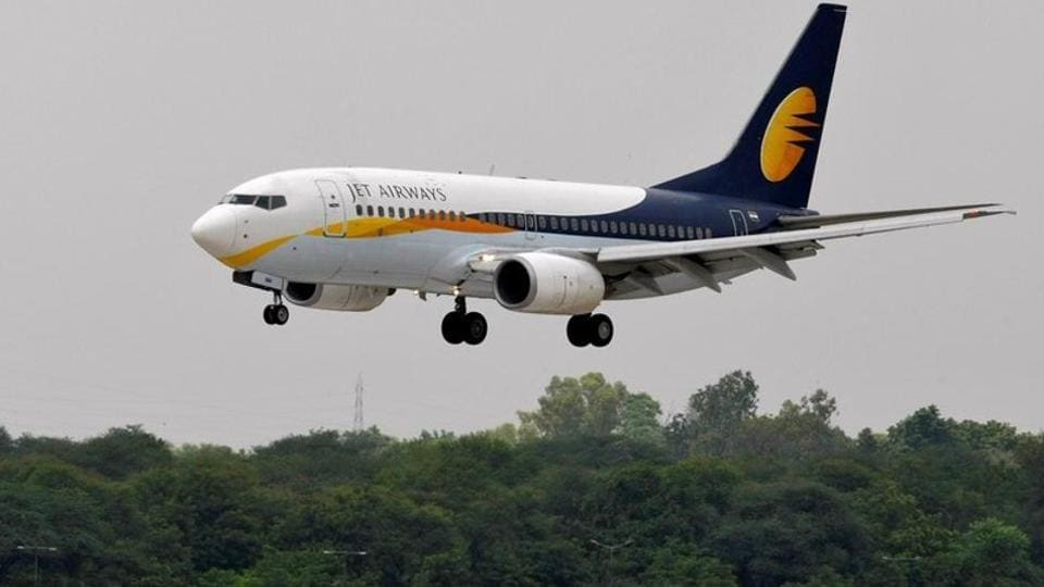 A Jet Airways passenger aircraft prepares to land at the airport in Ahmedabad.
