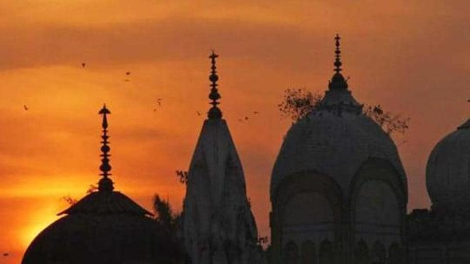 Birds fly at sunset over a Hindu temple on the 20th anniversary of the Babri mosque demolition in Ayodhya.