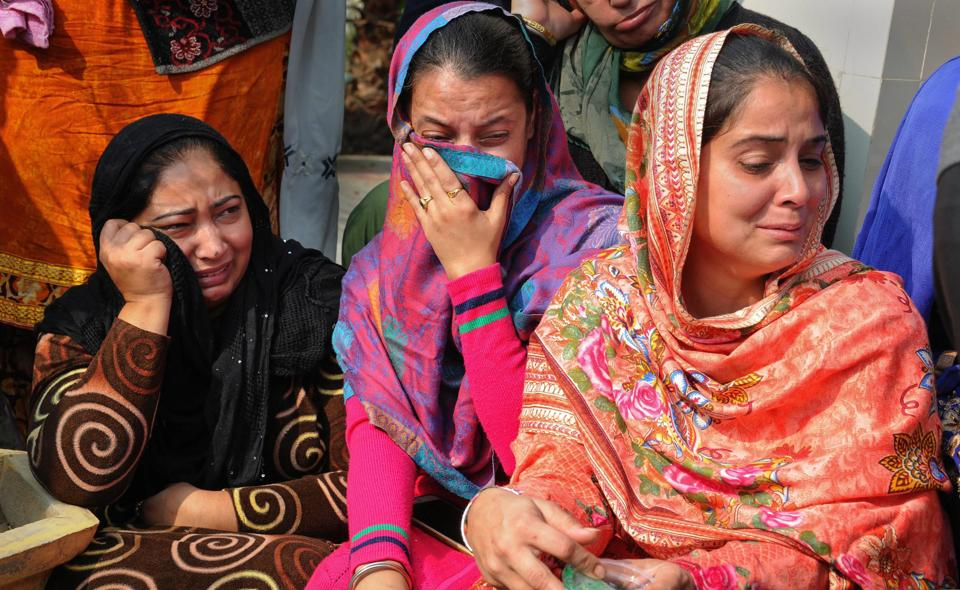 Relatives mourn the death of Sandeep Singh (17), at his funeral, in Amritsar. Three people were killed and over 20 injured when two motorcycle-borne men threw grenade on a religious congregation on inside the Nirankari Bhavan's prayer hall at Adliwal village near Amritsar's Rajasansi on Sunday. (PTI)