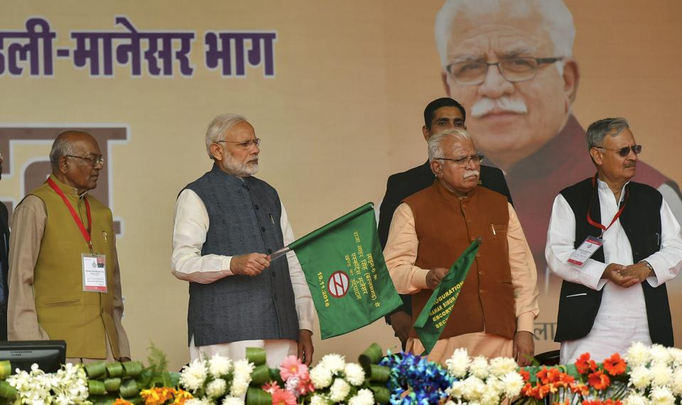 Prime Minister Narendra Modi and Haryana Chief Minister Manohar Lal Khattar inaugurates the Ballabhgarh-Mujesar Metro Rail Line, at Sultanpur village, in Gurugram. Modi was accompanied by Chief Minister Manohar Lal Khattar, Union ministers Rao Inderjit Singh, who is a Gurgaon MP, and Birender Singh. (Kamal Kishore / PTI)