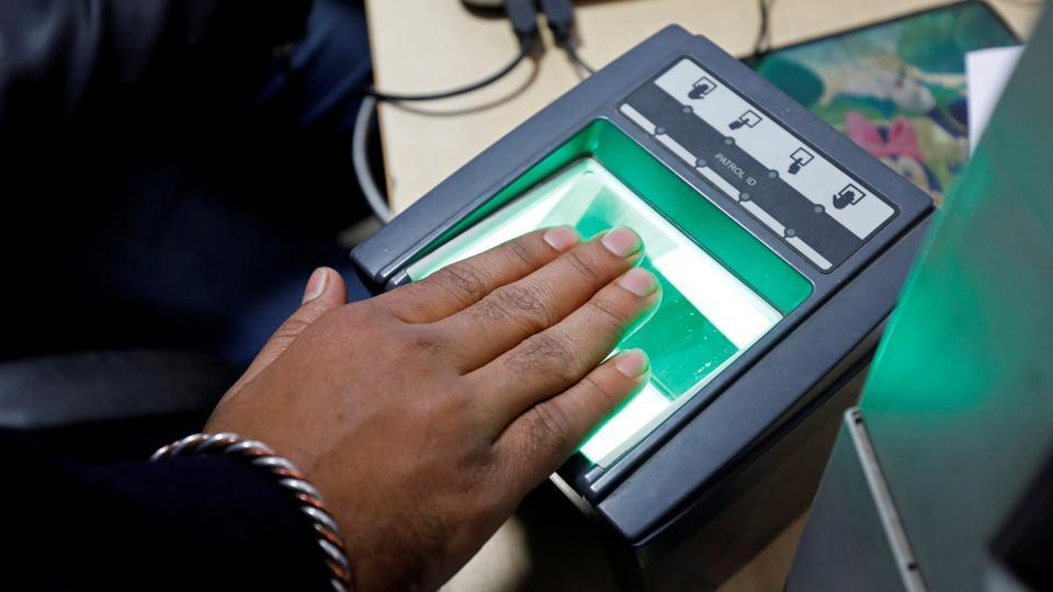A woman goes through the process of finger scanning for Aadhaar, at a registration centre in New Delhi.