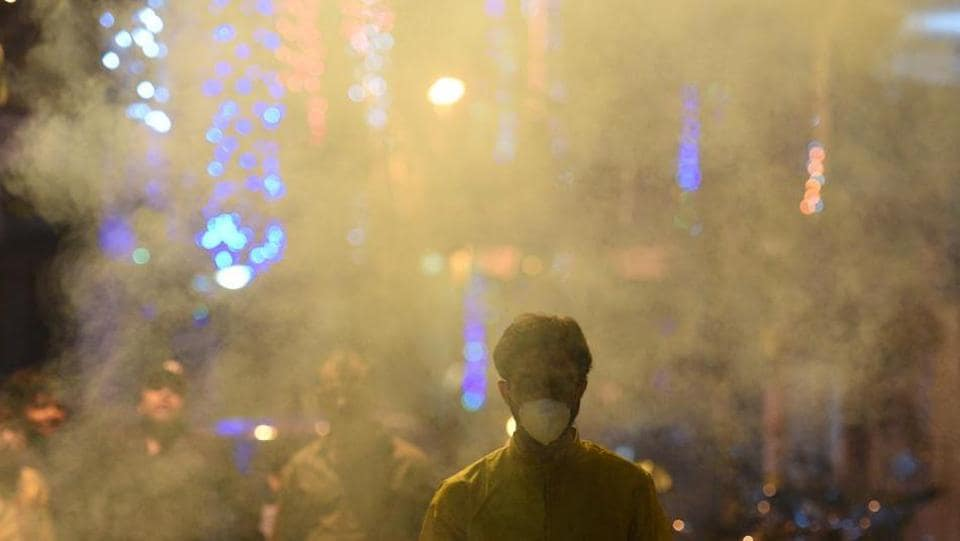A man wears an anti-pollution mask to protect himself from the pollution caused by bursting of firecrackers during Diwali  in Delhi