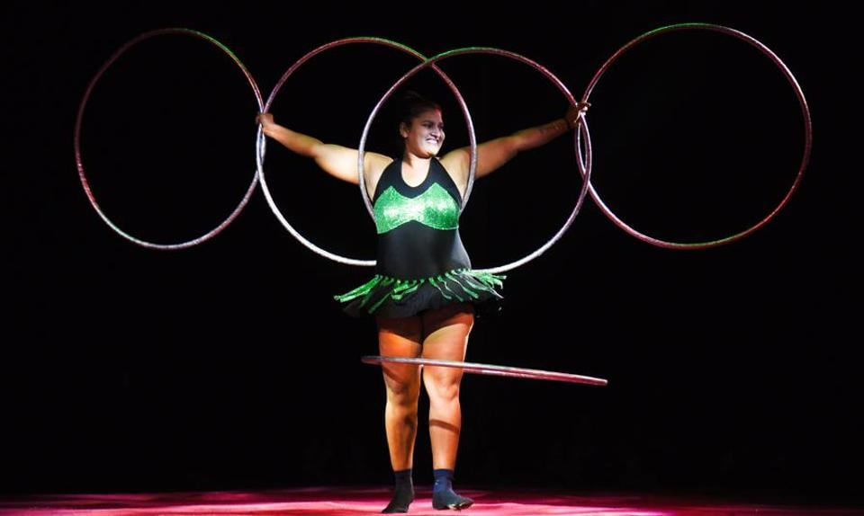 Artist of Rambo circus perform a 'hoola hoop' stunt in Mundhwa on Saturday. Rambo Circus was established by PT Dilip on 26 January, 1991.  (SANKET WANKHADE/HT PHOTO)