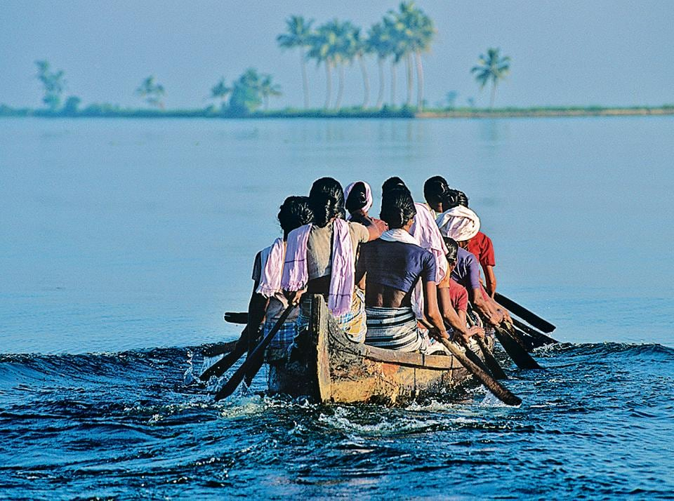 Together yet alone:Women setting out across the backwaters in Kerala.