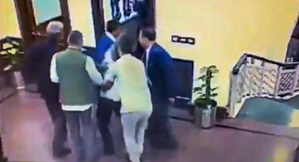 A still from a video posted by the AAP on its twitter account shows Anil Kumar being held after he allegedly threw chilli powder at Delhi Chief Minister Arvind Kejriwal, outside his chamber at Delhi Secretariat in New Delhi on November 20.