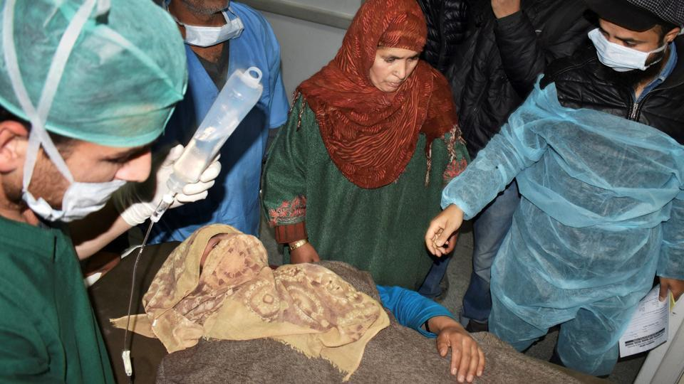 A woman injured in an encounter in Shopian is treated at SMHS hospital in Srinagar. One army soldier and four militants were killed in the encounter that also left three soldiers injured in Jammu and Kashmir's Shopian early on Tuesday. A police officer said a search operation turned into an encounter after the militants fired on the forces, triggering retaliation. (PTI)