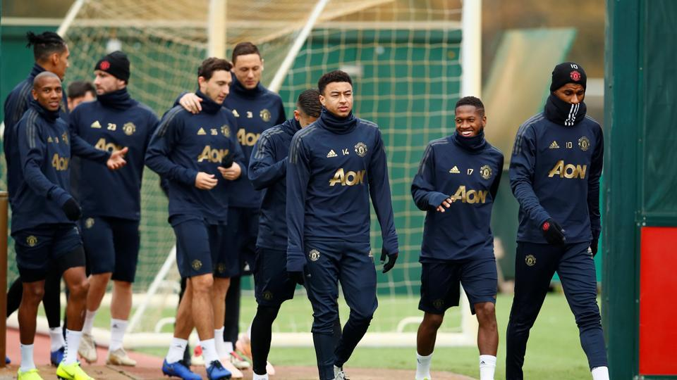 Manchester United's Jesse Lingard, Fred and Marcus Rashford during training.