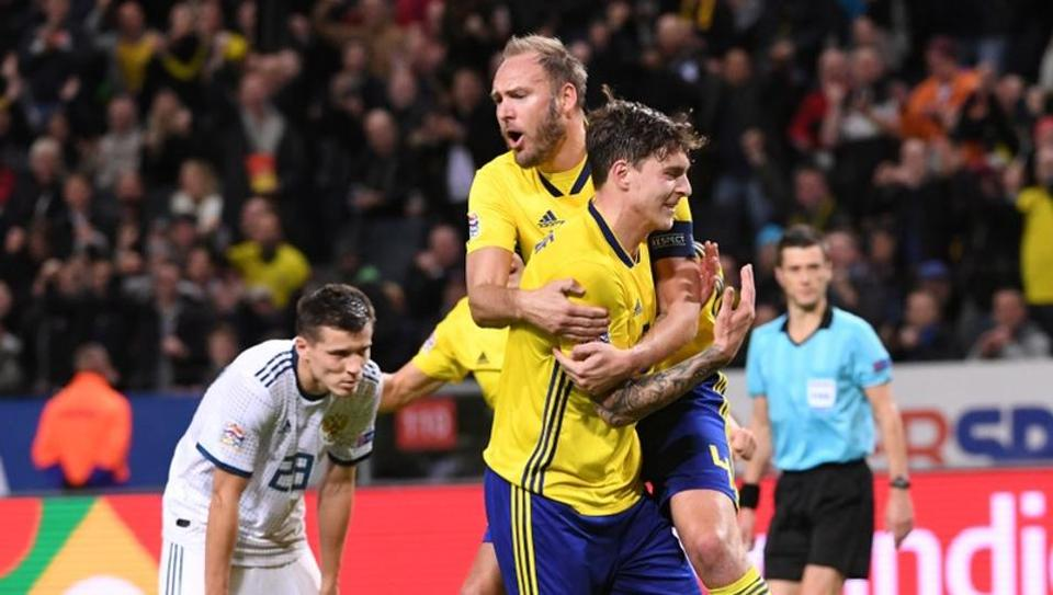Sweden's Victor Nilsson Lindelof celebrates his goal with teammate Andreas Granqvist.