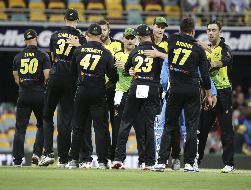 Australia players celebrate after winning the first T20 International cricket match between Australia and India in Brisbane, Australia. (AP)