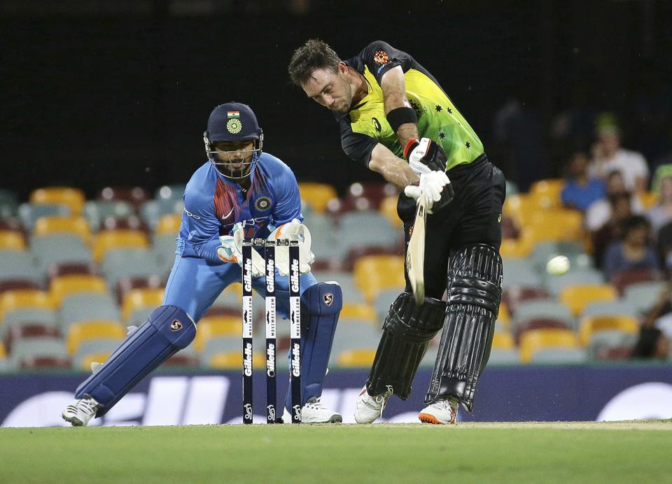 Australia's Glen Maxwell, right, plays a shot as Indian wicketkeeper Rishabh Pant, left, looks on during the first T20 International cricket match between Australia and India in Brisbane. (AP)