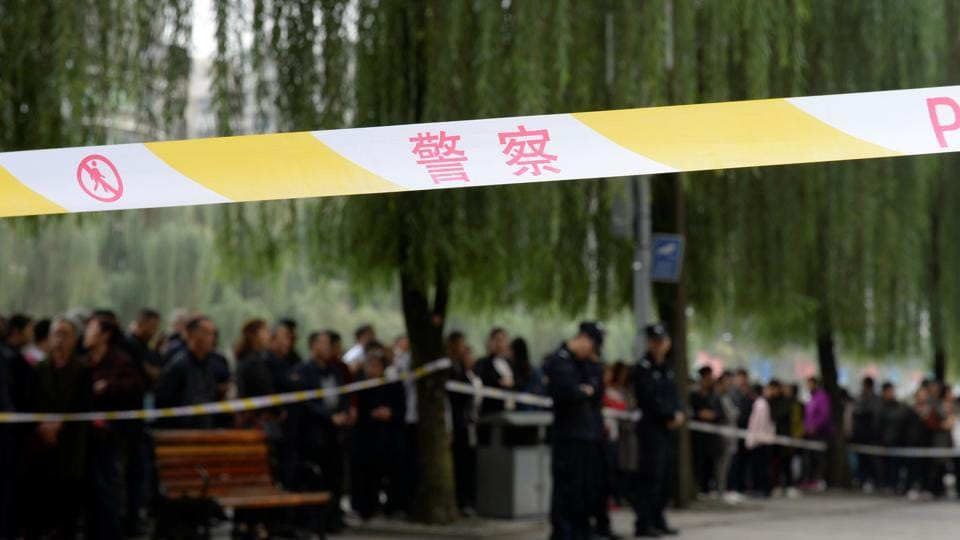 China state media Children hurt by vehicle outside school