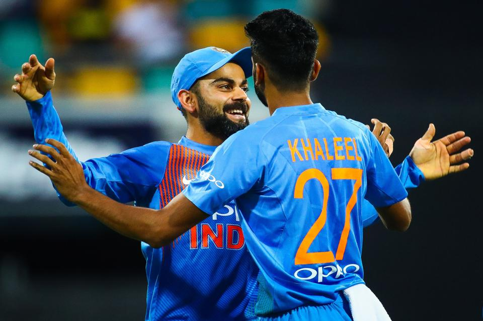 India's Virat Kohli (L) congratulates teammate Khaleel Ahmed on dismissing Australia's batsman D'Arcy Short during the T20 international cricket match between Australia and India in Brisbane. (AFP)