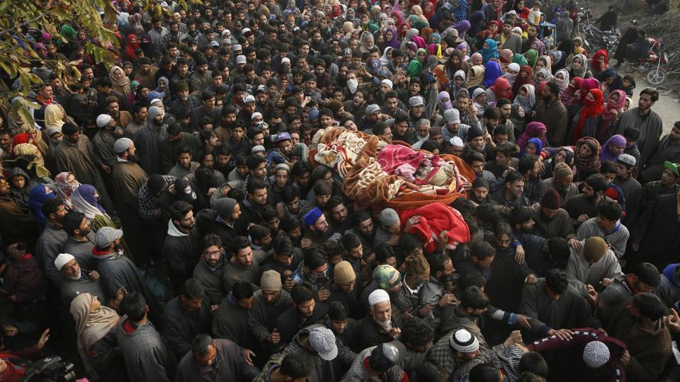 Kashmiri Muslim villagers carry the body of rebel Abid Chopan during his funeral at Shopian, south of Srinagar, Jammu and Kashmir on November 20, 2018. (Mukhtar Khan / AP)