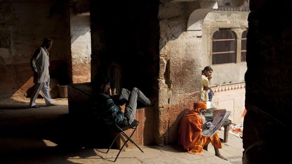 Men sit near Meer Ghat in Varanasi, Uttar Pradesh on November 21, 2018. (Xavier Galina / AFP)