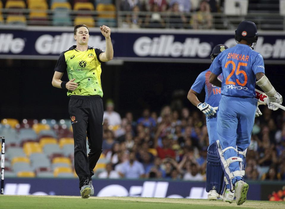 Australia's Jason Behrendorff, left, appeals for the wicket of India's Shikhar Dhawan, right, during the first T20 International cricket match between Australia and India in Brisbane. (AP)