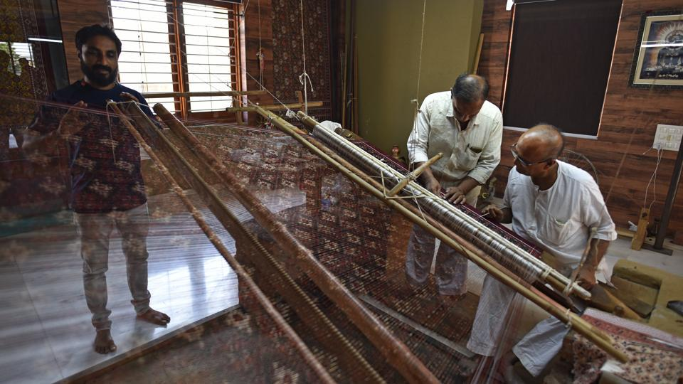 Two generations of a Salvi family work the loom to create the double ikat Patola, that is made only in this Gujarat town. If the Rani Ki Vav is the pride of Patan, the other thing that this little Gujarat town can claim to have a national monopoly over, is the double ikat silk weave. (Sanchit Khanna / HT Photo)