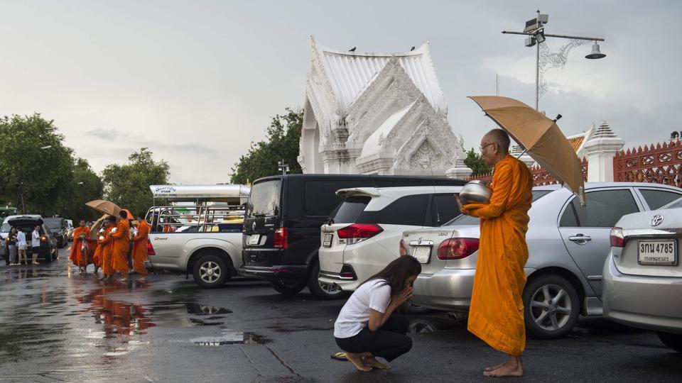 "Pre-packed alms that include processed foods are also easily available at Thai stores, exacerbating the problem. Although new guidelines call on monks to look after their health so they can be ""ready to deliver Buddha's teachings"", refusing devotees' offerings is a delicate subject. (Romeo Gacad / AFP)"